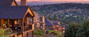 Home page image of redwood stained multi -level home o hill. Homes and hills, and Mountains in the background. Denver area foreclosures.