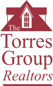 Large home page Torres Group Realtors Header Logo, white back ground with red text